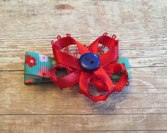 red flowered bow on a non slip alligator clip