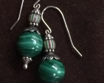 Earrings of malachite with striped drawn trade beads and Bali silver