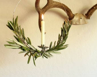scandinavian olive branch wreath with vintage candle holder