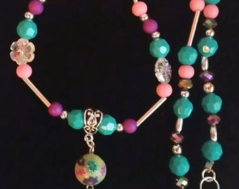 Turquoise pink and purple beaded necklace.