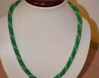 Crocheted bead necklace in green with silver Spiral