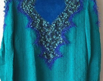 Handmade knitted blue turquoise sweater