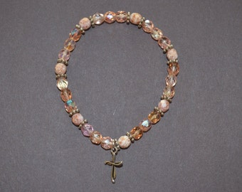 CLEARANCE Bracelet, 7.5 inch pink beaded stretch bracelet with cross charm