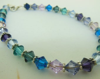BLUE teal, pink purple, green 6mm bicone bracelet with silver spacers