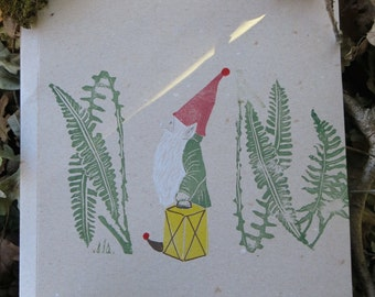 Folder/portfolio illustrated with forest gnome elf with ferns and lantern