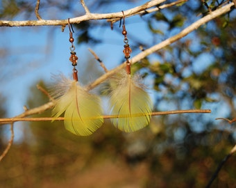 Yellow Feathers with Brass Accents