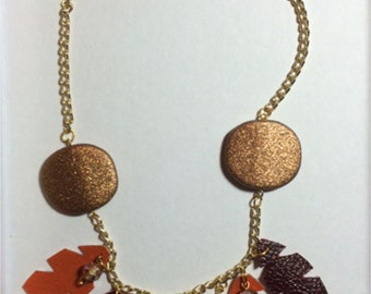 Necklace gold, leaves red and orange leather