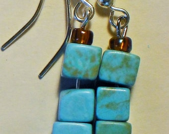 Turquoise cubes with amber beads.