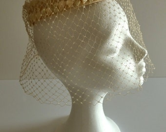 Vintage beige headdress. 1960s