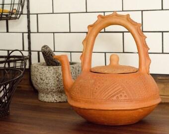 Vintage terracotta teapot
