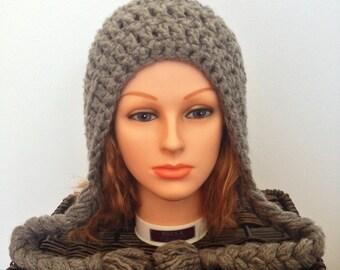Women's Crochet Winter Hat with Braids and Pom Pom
