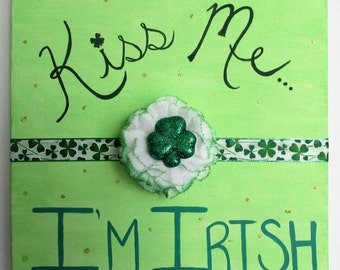 "Kiss Me... I'm Irish     12"" x 12"" Acrylic on Canvas, featuring ribbon and a silk flower"