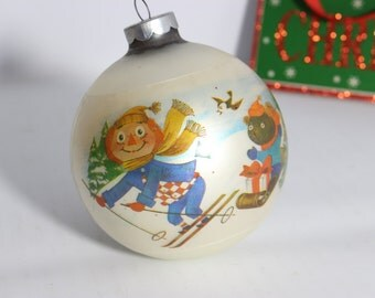 Raggedy Andy Christmas Ball / Mercury Glass with Plastic Sleeve Cover - Made in USA