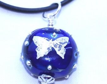 Lampwork pendant - silver butterfly on dark blue glass with fine silver spots - SRA
