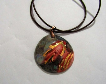 Handmade ceramic pendant, gold and mother of Pearl luster.