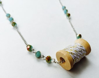 Handmade, vintage inspired Wooden Spool necklace with blue and brown beads