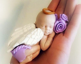Sleeping Angel Baby Girl in purple sculpture for miscarriage, baby loss, with wings