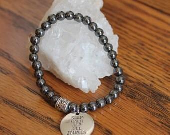 Hemitite Stretch Bracelet with Zombie charm