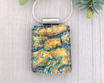 Multicoloured dichroic glass pendant with rivers of golds and a touch of green and purple