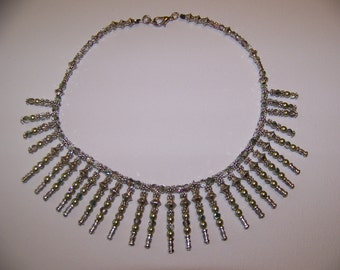 Metal and crystal necklace in green
