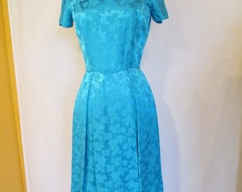 1960s Blue floral brocade dress with pleated faux wrap skirt XS S