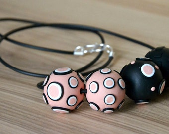 Long necklace pink and black, romantic colors and modern style. Handmade polymer clay. Rubber cord