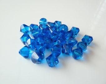24pcs 6mm Swarovski Capri Blue Bicone Crystals- Swarovski 5328- Item CB6B