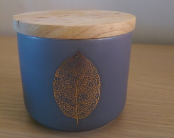 Grey and golden leaf canister