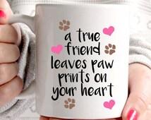 A true friend leaves paw prints on your heart dog mug