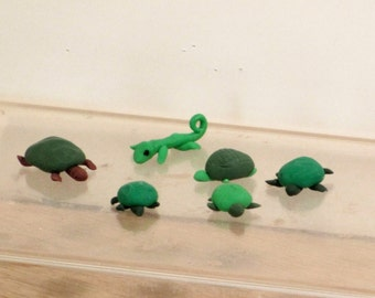 One miniature green pet turtle