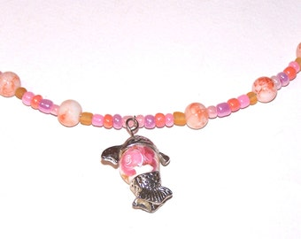pink and orange glass necklace with floral fish pendant
