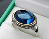 AAAA Natural London Blue Topaz Cabochon 14x10mm 6.5 Carats in 18K Yellow gold and Sterling silver ring.  0828 y