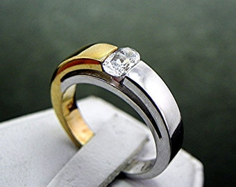 18K gold two tone ring set with .70 carat  6x4mm oval White Diamond
