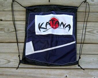 Black Drawstring Backpack with Blackberry Purple Katana Parachute End Panel Applique