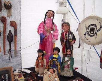 Cherokee ribbon dress and gourd dancer dolls