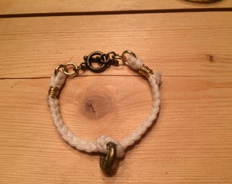 braided cotton bracelet with brass ring charm