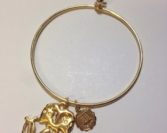 Vintage goldtone Gemini zodiac tension charm bracelet