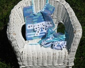 Paw prints dance across this baby boy bib and booties set - perfect for baby shower gift