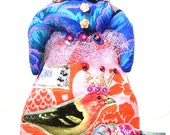 Fun Small Handmade Cloth Art Doll With A Blue Bird On Top Of Her Head Wearing A Crowned Bird Appliqued Skirt
