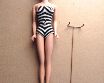 Vintage 850, Titan Bubble cut Barbie. BARBIE doll.  1960s Mattel.  Straight leg.  With zebra stripe swimsuit & heels.