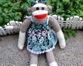 Dressed Little Girl Sock Monkey Doll, Aqua Print Diapers, Dress, Bow, Shoes.
