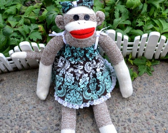 Dressed Little Girl Sock Monkey Doll, Aqua Print Diapers, Dress, Bow, Shoes.