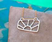 Framed Sunburst in Silver and Gold