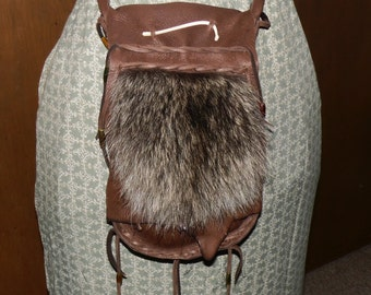 Mountain man raccoon fur and leather possibles bag baculum bone