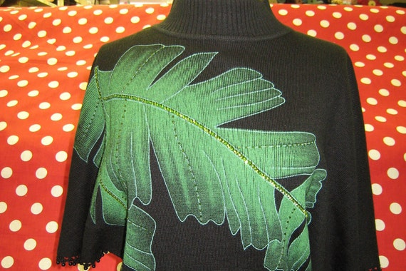 Black color sweater with green leaves print and sequined embroidery in the front side for decoration (c39)