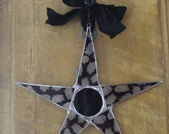 Flying Spooks Star- 10 inch lacquered fabric on glass points with black art glass center