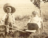 Little Boy PULLING His YOUNGER BROTHER In a Wheelbarrow Photo Postcard 1911