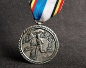Seventies souvenir medal. 1977 cross country running meeting award.