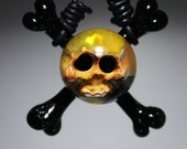 Green Sparkle Skull And Crossbones Art Glass Pendant by Tim Keyzers