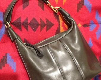 Blowout Sale. Vintage COACH black leather shoulder bag. Excellent vintage condition. Minimalistic. Smart Casual.